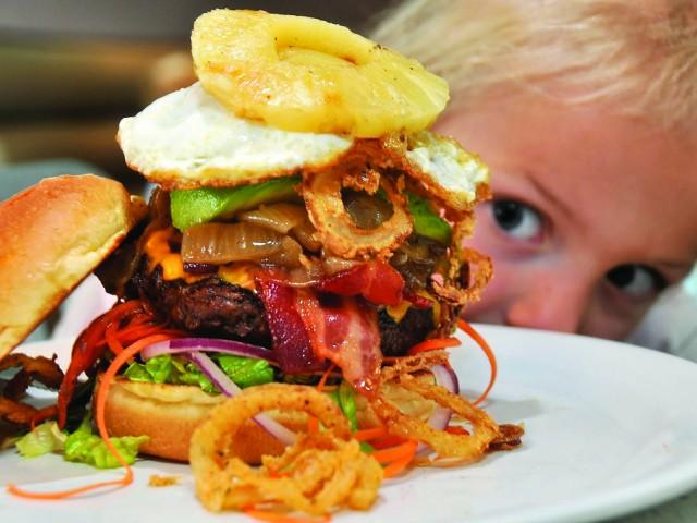 The Counter's famous burger hypnotizes a customer.